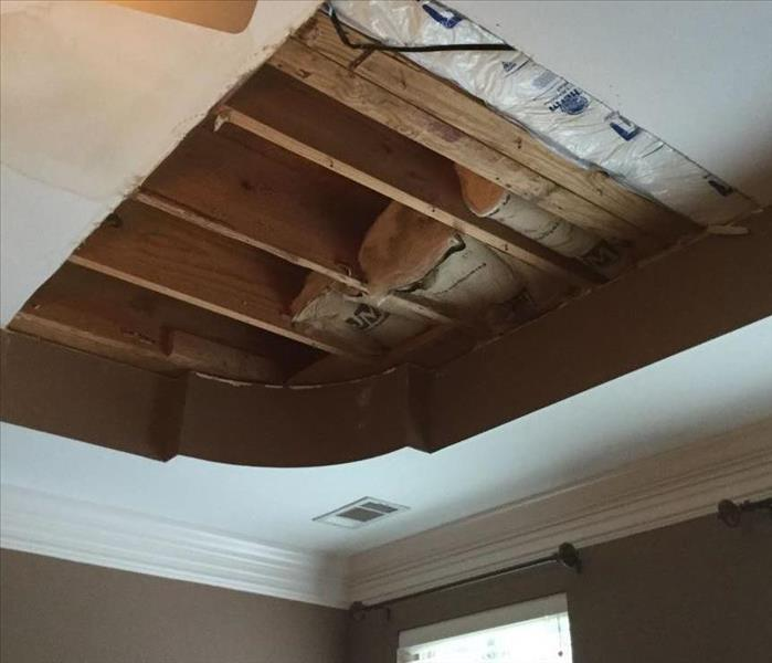 water damaged ceiling with insulation and drywall removed