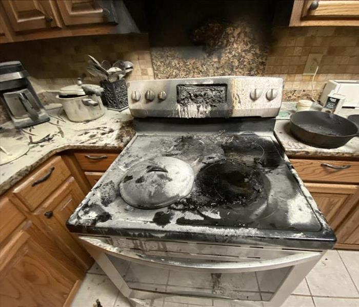 Fire damaged stovetop and oven