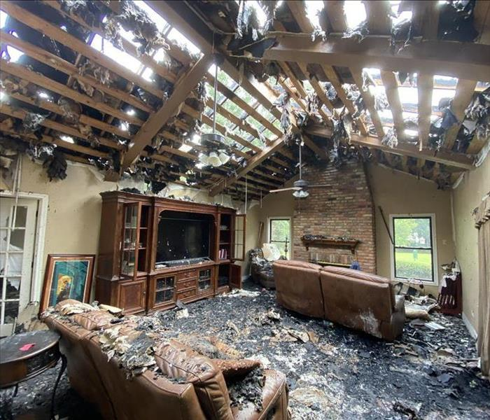 Living room with destroyed ceiling